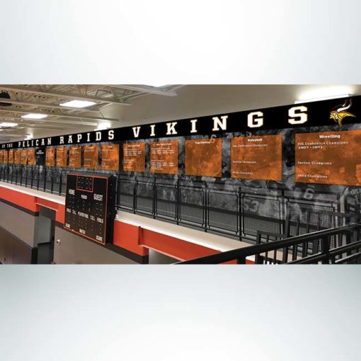 School branding wall wrap in gymnasium with black and white graphics and athletic championships.
