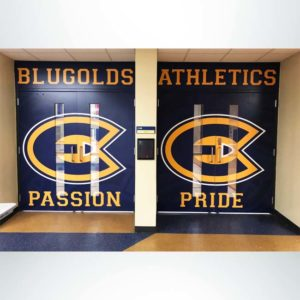 Custom door wrap with overhead wall graphic leading into gym.