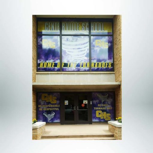Perforated window film on windows at the front entrance of school.