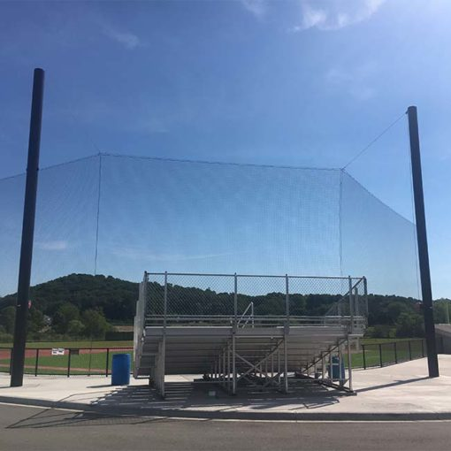 Tie-back backstop netting at baseball field.