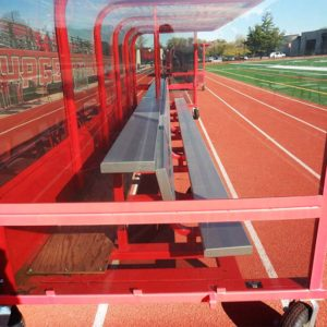 Model #ABS20BUILTIN. 20' aluminum bench with top shelf built into players shelter. Close up side view.