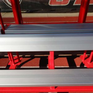 Model #AB20SBUILTIN. 20' aluminum bench with top shelf built into player shelter. Close up view.