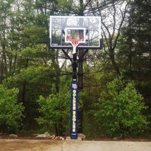 Captain Goalsetter inground basketball hoop in backyard.