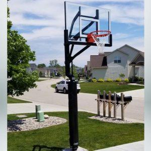 Model #CONTENDERINGL. Goalsetter Contender backyard basketball hoop shown installed in driveway.