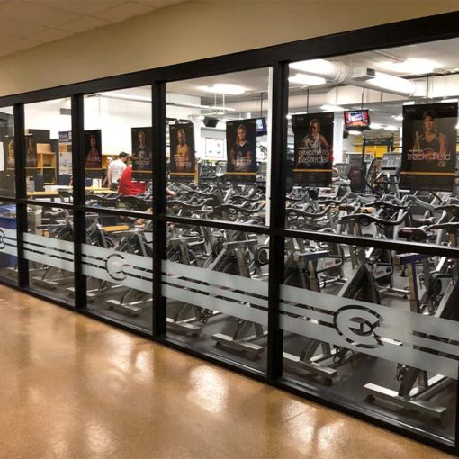 Frosted crystal vinyl on fitness center windows.