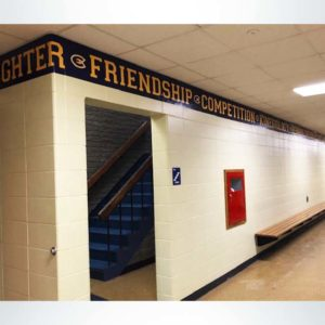 Wall banding in school hallway with character words.
