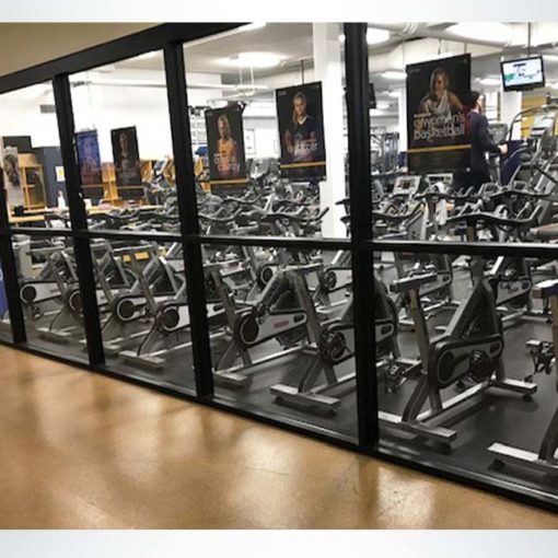 Fitness center windows shown before frosted crystal vinyl is installed.
