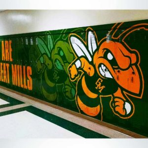 Locker wrap with green and yellow graphics.