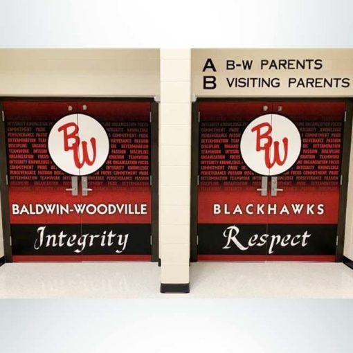 School branding vinyl double door wrap on school doors in red and black with school logo and character words.