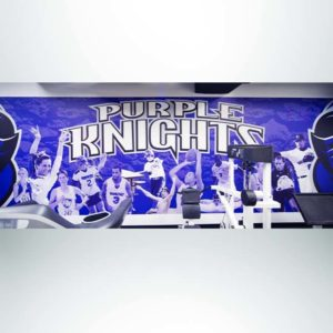 Wall wrap with school logo and photos in weight room.