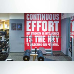 School branding wall wrap with core values in weight room.