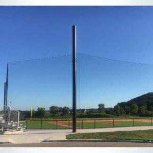 Tie-back backstop net for baseball field.