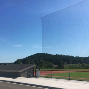 Tie-back nets at high school baseball field.