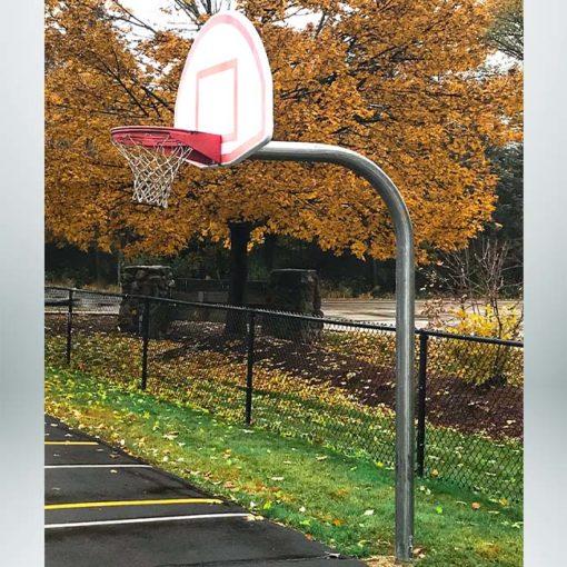 Model #KG4908. 8' high gooseneck basketball pole at school playground.