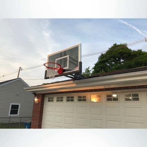 Roofmaster roof mount basketball hoop on grage roof.
