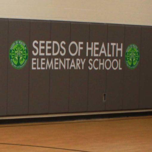Custom logo wall pads for school gymnasium.