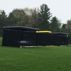 Model #1020. Two 10' x 20' World Series dugouts with windscreen for softball and baseball field.
