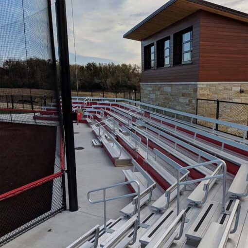 Custom aluminum bleachers with backrest and red risers.