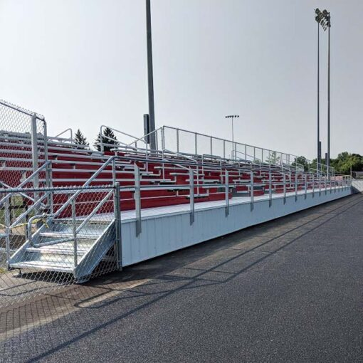 Custom elevated bleachers with red risers.