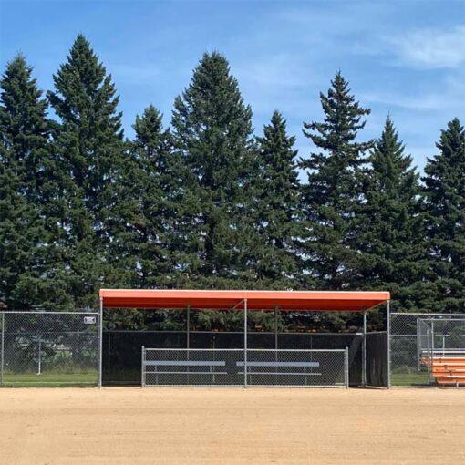 Model #DG1030POWDERGIRTS. 30' team dugout with orange top.