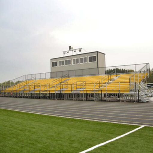 Elevated bleachers with yellow risers and press box.