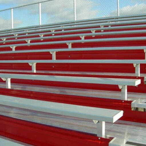 Elevated bleachers with red risers.