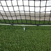 Protective netting attached to the ground with cable & clips.