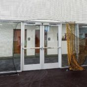 Protective netting with an opening for doors.