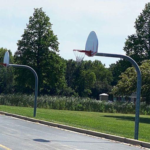 "Model #KG690SSUR. Gooseneck basketball pole with 6' overhang and 5 9/16"" pole."