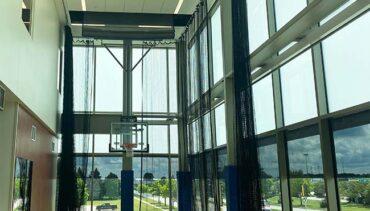 Walk-draw netting & motorized basketball hoop.