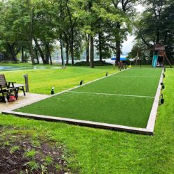 Artificial turf for backyard bocci ball.
