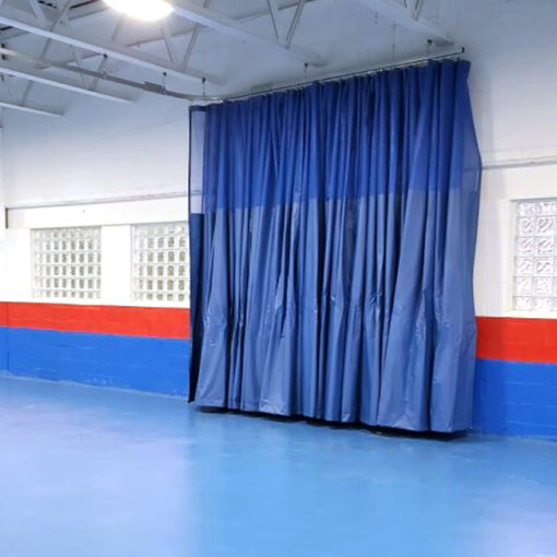 Gym divider curtain with Besteel track.