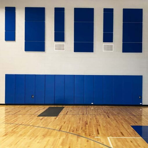 Blue wall padding in gymnasium at Cristo Rey High School.