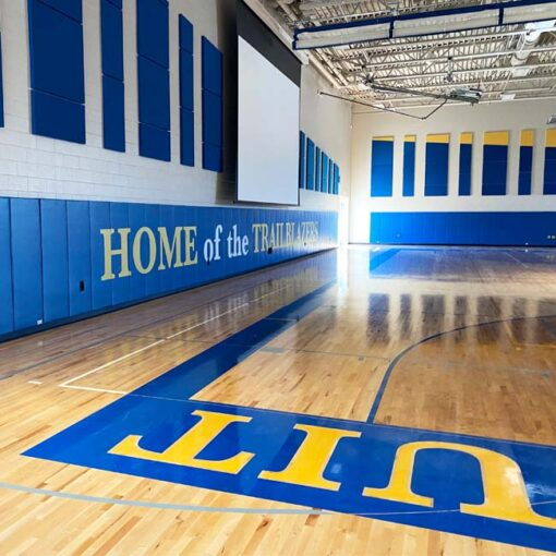 Wall padding with custom logo at Cristo Rey High School.