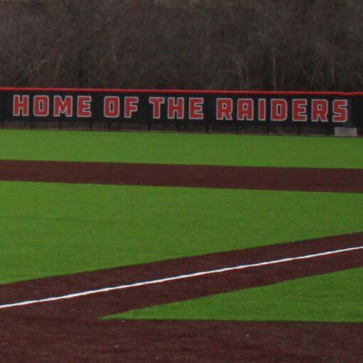 Windscreen on baseball outfield fence.