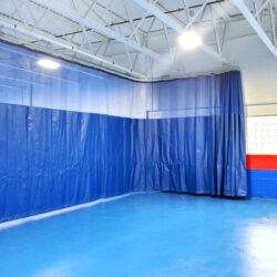 Walk-draw gym divider curtain.