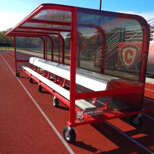 Model #ABS20. Built-in aluminum bench with top shelf inside team shelter.